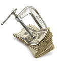Clamp Putting Pressure On American Money Concept by Keith Webber Jr