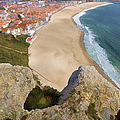 Cliff Of The Seaside Village Of Nazare by David Letts
