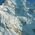 Climber Enjoying View Of Mt Cook by Colin Monteath