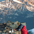 Climber Lights His Ultralight Stove by Christopher Kimmel