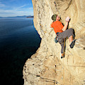 Climber Reaches For Hand Hold by Corey Rich