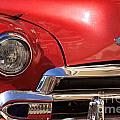 Close Up Of A Red Chevrolet by Deborah Benbrook