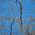 Close Up Of Cracks On A Blue Painted by Perry Mastrovito
