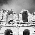 Close Up Of The Top Of The Old Roman Colloseum Against Blue Cloudy Sky El Jem Tunisia by Joe Fox