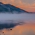 Cloud Reflection And Fog On Lake Tahoe by Marc Crumpler