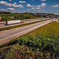 Clover Leaf Exit Ramps On Highway Near City by Alex Grichenko