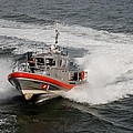 Coast Guard In Action by Rob Hans