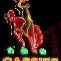 Cody Wyoming Neon Lounge Sign At Night by John Malone