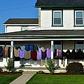 Colorful Amish Laundry On Porch by Tana Reiff