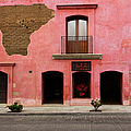 Colorful Pink Building With Coffee Shop by Dennis Walton