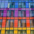 Colorful Windows On Modern Apartment Block by Ken Biggs
