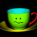 Confused Colorful Cup And Saucer by Natalie Kinnear