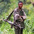 Congolese Soldier Standing Guard by Bob Parr