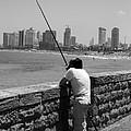 Contemplative Fisherman In Tel Aviv by Joshua Van Lare