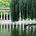 Corinthian Colonnade And Pond by Ron Koeberer