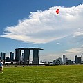 Couple Flies Kite Marina Bay Sands Singapore by Imran Ahmed