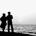 Couple Looking Out To Sea by Jagdish Agarwal