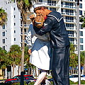 Couple Looking Up To The Famous Wwll Kiss Statue In Sarasota. by Robert Birkenes