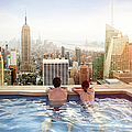Couple Relaxing On Hotel Rooftop by Orbon Alija