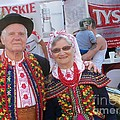 Couples In Polish National Costumes by Lingfai Leung