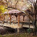Covered Bridge On The River Walk by Debra and Dave Vanderlaan