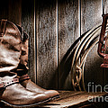 Cowboy Boots In Old Barn by Olivier Le Queinec