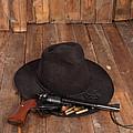 Cowboy Hat And Gun by Scott Sanders