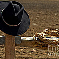 Cowboy Hat And Rope On Fence by Olivier Le Queinec