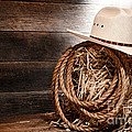 Cowboy Hat On Hay Bale by Olivier Le Queinec