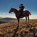 Cowboy Looks Out Over Historic Last by Panoramic Images