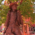 Cowboy Statue In Front Of The Brown Palace Hotel In Denver by John Malone