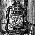 Cowboy Themed Wood Barrels And Lantern In Black And White by Paul Ward