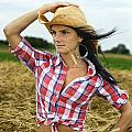Cowgirl Holding Hat Vertical by Sylvie Bouchard