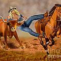 Cowgirl Steer Wrestling by Glenn Holbrook