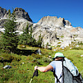Cropped Rear View Of A Female Hiker by Ron Koeberer