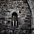 Crosses And Stone Walls At Clonmacnoise by Nadalyn Larsen