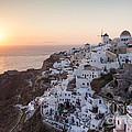 Cruise Ship At Sunset In The Mediterranean Sea Santorini Greece by Matteo Colombo