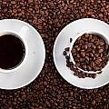 Cup Of Coffee And Cup With Coffee Beans by Raimond Klavins