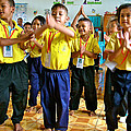 Dancing Kindergarten Students At Baan Konn Soong School In Sukhothai-thailand by Ruth Hager