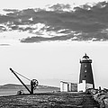 Davit And Lighthouse On A Breakwater by Semmick Photo