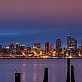 Dawn Panorama Of Downtown Seattle From Alki Beach by Silvio Ligutti