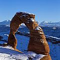 Delicate Arch In Snow Arches National Park Utah by Jason O Watson