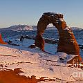 Delicate Arch With Snow At Sunset Arches National Park Utah by Jason O Watson
