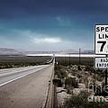 Desert Highway Road Sign by Konstantin Sutyagin