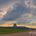 Devils Tower On The Horizon At Sunset by John Malone