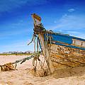 Dilapidated Boat At Ferragudo Beach Algarve Portugal by Amanda Elwell