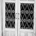 double wooden doors with wrought iron decorative window guards Tenerife Canary Islands Spain by Joe Fox