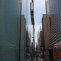 Down E 43rd Street N Y C by John Schneider