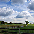 Dramatic Blustery Sky Over The Hayfield by Byron Varvarigos