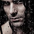 Dramatic Portrait Of Young Man Wet Face With Long Hair by Oleksiy Maksymenko